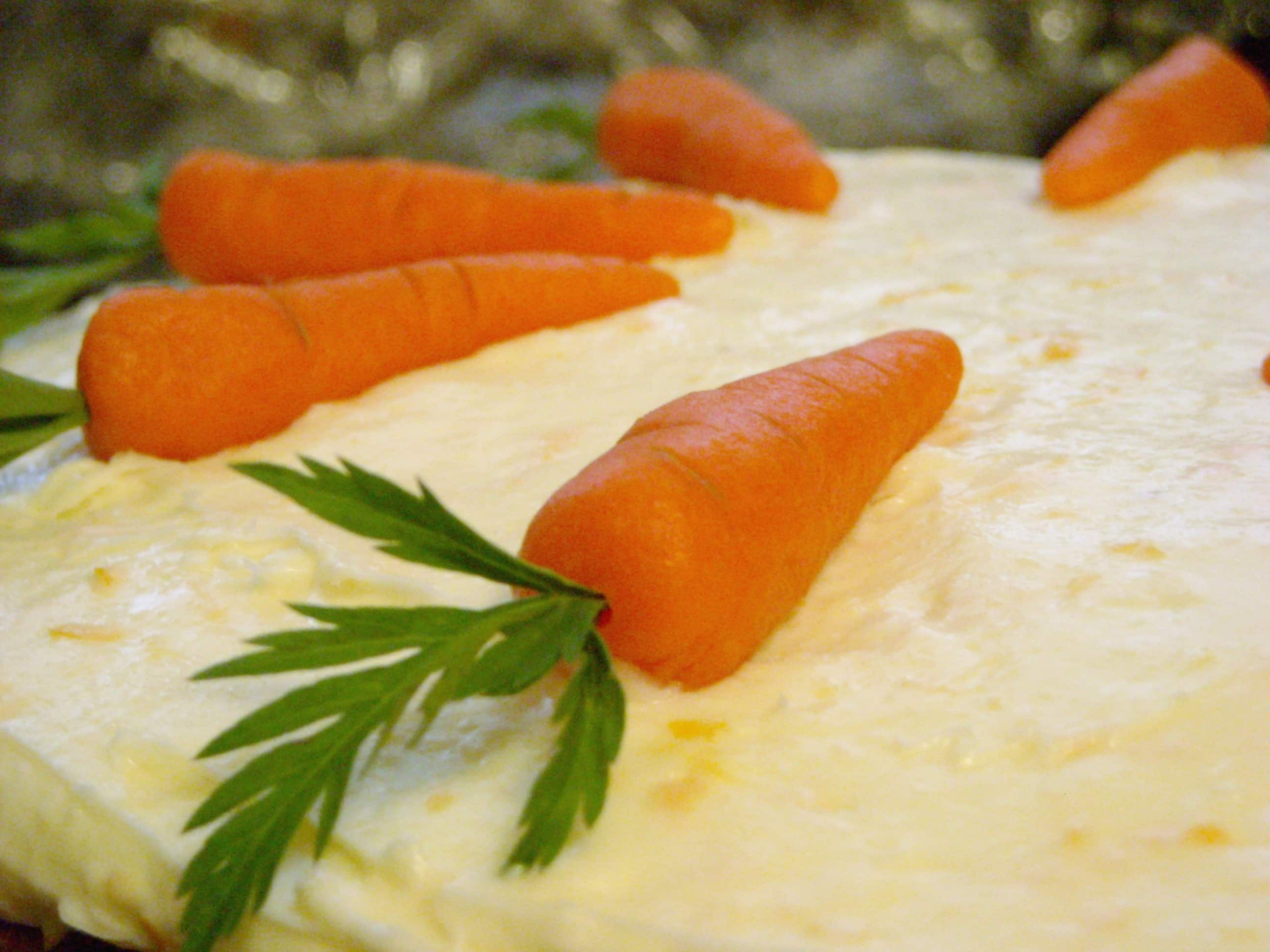 This sweet recipe for orange cream cheese frosting and marzipan carrots. It's the perfect topping for brownies, cake or cookies.