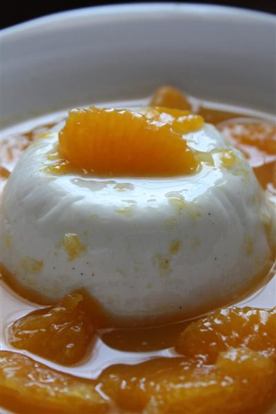 This cardamom yogurt pudding is scented with vanilla, drizzled with a homemade cinnamon honey syrup and topped with fresh orange segments.