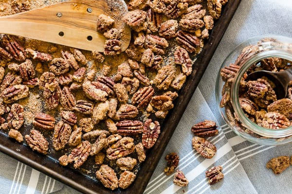 Sweet slow roasted praline pecans. Spiced with cocoa powder, cinnamon, sugar and just a touch of kosher salt. These nuts are perfect for snacking!