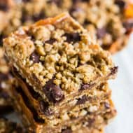 These chewy caramel oatmeal bars are super easy to make and make the perfect dessert treat for any holiday party. They are a delicious combination of oatmeal cookie, chewy caramel, and chocolate.