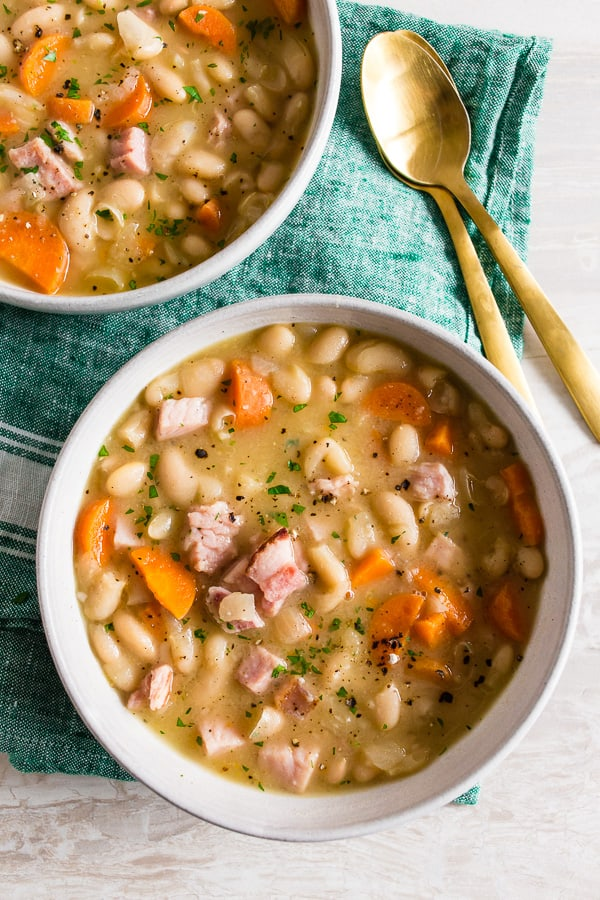 This quick and easy ham and bean soup is packed full of white beans, smoked ham, carrots, and onions. It's ready in just 30 minutes and a hearty way to use up all that leftover holiday ham.