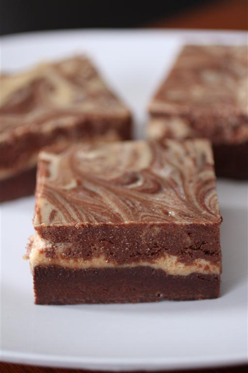 These peanut butter chocolate cheesecake brownies are the perfect combination of delicious flavor. A layer of fudgy brownie topped with chocolate peanut butter swirl cheesecake. What's not to love?