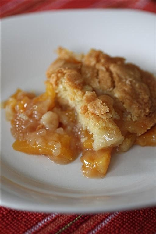 This frozen peach cobbler is sweet and simple and to throw together. You use frozen peaches right from the freezer so you always have time to make this beauty. Inspired from Joanne Fluke book Peach Cobbler Murder.