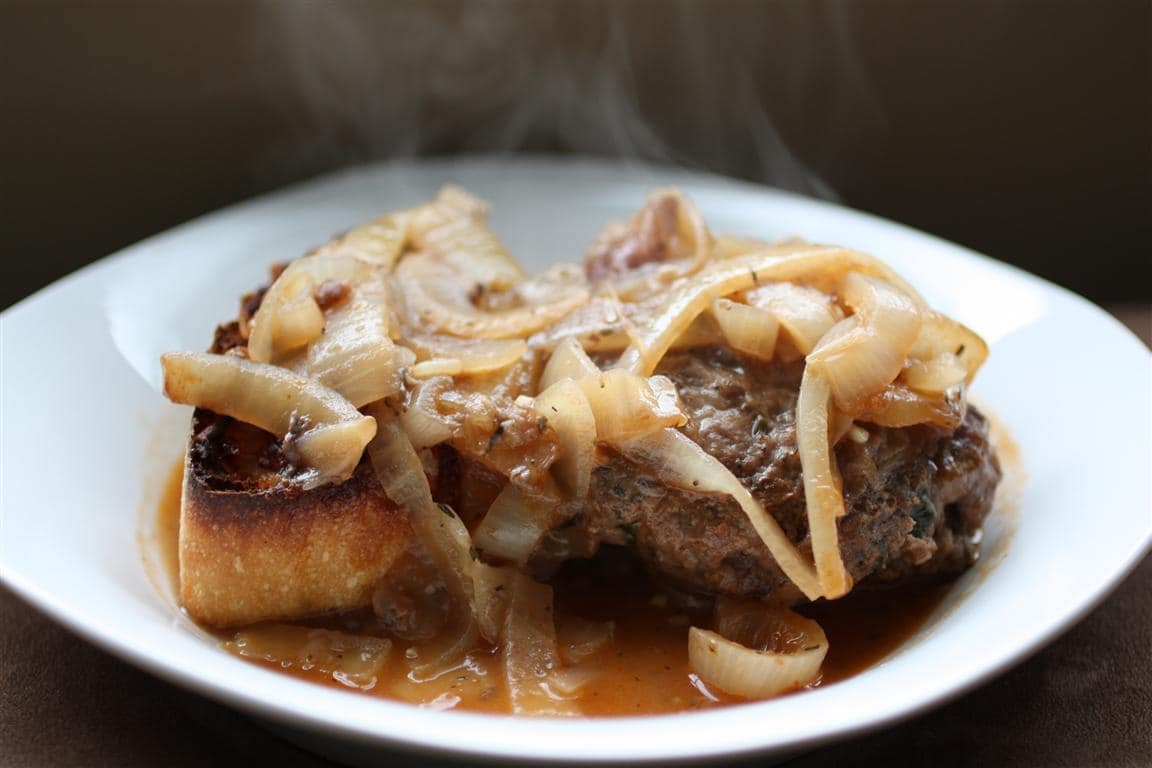 Tender and delicious French onion Salisbury steak. Smothered in slow cooked onions, beef stock and red wine. Served with a side of cheese toast.