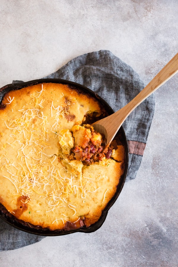 This buttermilk cornbread topped chili is the perfect combination of thick hearty chili and lightly sweetened cornbread. It's similar to a casserole and works perfectly when made in a giant cast iron skillet. You'll love this dish!