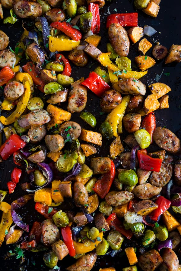 This sheet pan chicken sausage and vegetables is the perfect weeknight meal. It's hearty, full of vegetables and ready in no time. Plus there is only one sheet pan to clean up! Your whole family will love this dish!