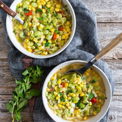 This super easy vegan and vegetarian succotash soup is packed full of lima beans, corn and fresh herbs. Ready in just 30 minutes and perfect for dinner or a light summer lunch. Trust me, you'll love this soup!