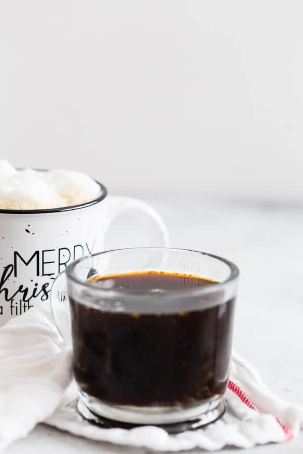 This homemade gingerbread syrup is made with dark brown sugar, molasses, lots of freshly grated ginger and a touch of winter spices. You'll love how easy this syrup is to make and it's perfect in hot lattes, iced coffee or even hot chocolate!