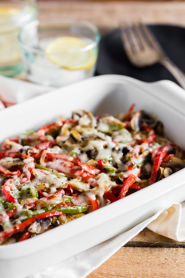This lightly smothered chicken is drizzled with homemade honey mustard and then covered in onions, peppers, mushrooms and just a little cheese. Perfect for your healthy diet but still packed with delicious flavor!