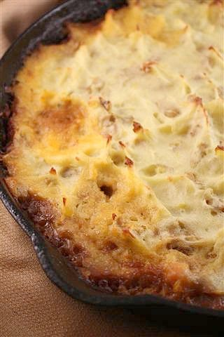 This delicious Irish stout shepherd's pie is full of ground lamb and diced vegetables. The Irish stout creates a thick gravy and is topped with potatoes.