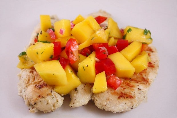 This mango salsa chicken combined fresh grilled chicken and tops it with a homemade mango salsa. It's packed with mango, pepper, cilantro and lime.