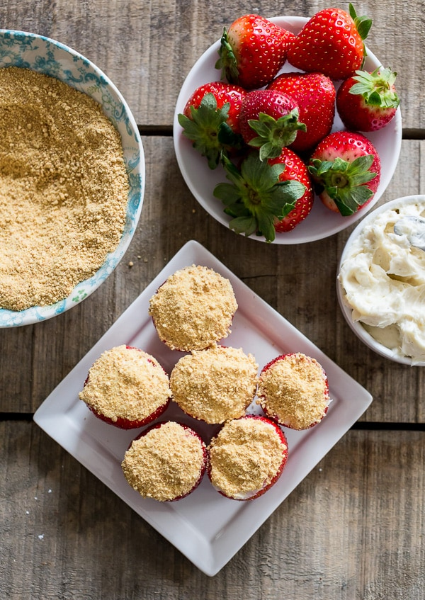 These cheesecake stuffed strawberries are simple to make and perfect for Valentine's Day. Stuffed with sweet vanilla cream cheese filling and topped with a dusting of graham cracker crumbs.