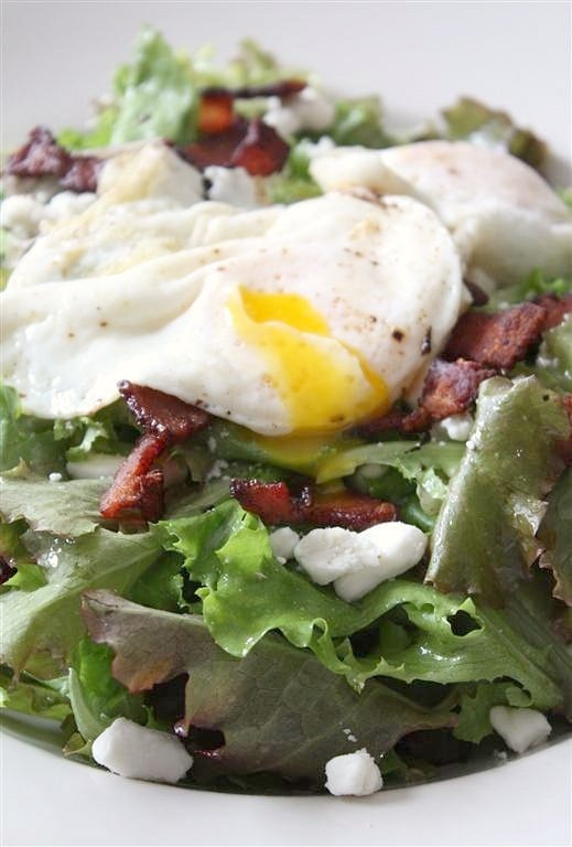 This mixed green salad with bacon, goat cheese, and fried egg is a great protein pack salad option. Made with a fresh homemade red wine vinaigrette and perfect for lunch or dinner. You'll love this easy salad!