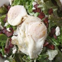 Mixed Green Salad with Bacon, Goat Cheese, and Fried Egg