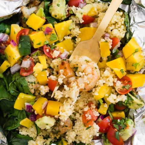 These shrimp couscous packets with avocado mango salsa are the perfect throw it together dinner. All you need to do is wrap it all up in foil, bake or grill and top with salsa. So easy and totally delicious! Ready in under 30 minutes!