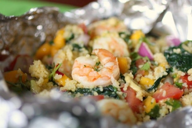 This shrimp couscous packets with avocado mango salsa is the perfect throw it together dinner. All you need to do it wrap it all up in foil and bake or grill. So easy and totally delicious! Ready in under 30 minutes!