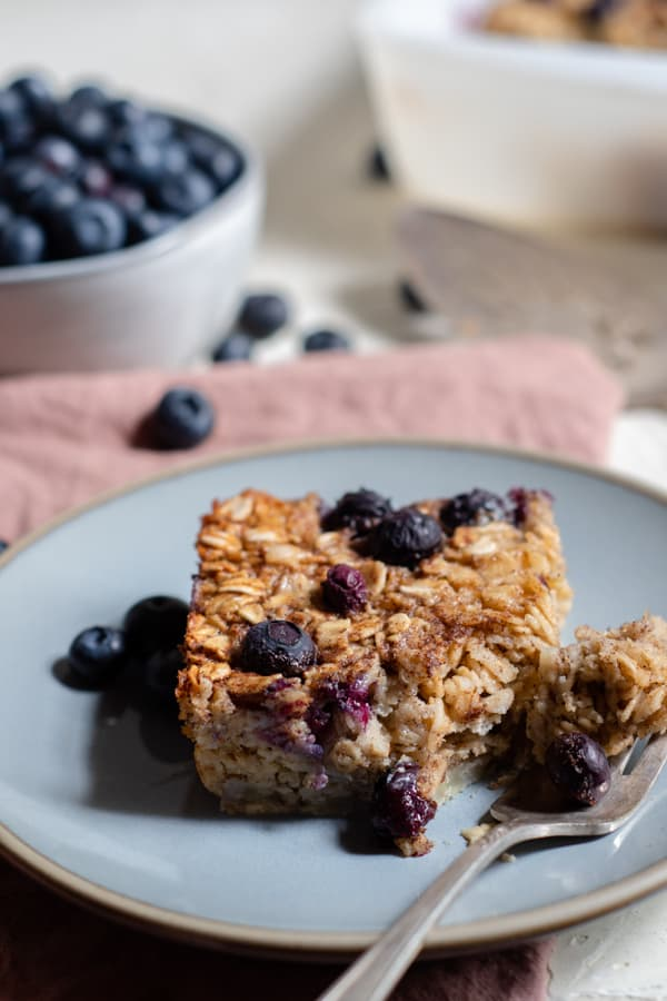 baked blueberry oatmeal on a plate with a fork
