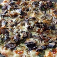 This caramelized onion mushroom and lambs quarters pizza is packed full of flavor and seasonal ingredients. If you can't find lambs quarters try arugula.