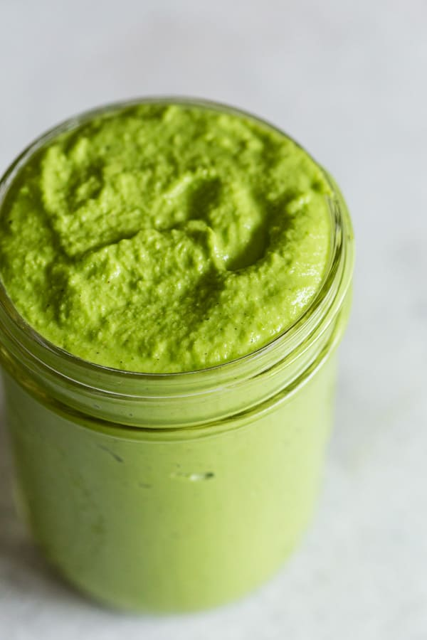 This homemade garlic scape pesto is perfect for pasta, pizza, sandwiches or on top of homemade vegetable soup. It packs TONS of flavor and is made right in your Vitamix, regular blender or food processor.