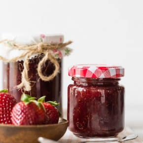 vanilla bean strawberry jam in small glass jars