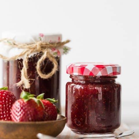 vanilla bean strawberry jam in small glass jars