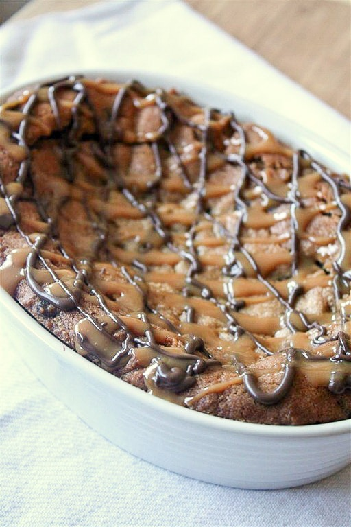 This super deep dish chocolate chip cookie is packed full of flavor and drizzled with melted chocolate and lots of salted caramel.