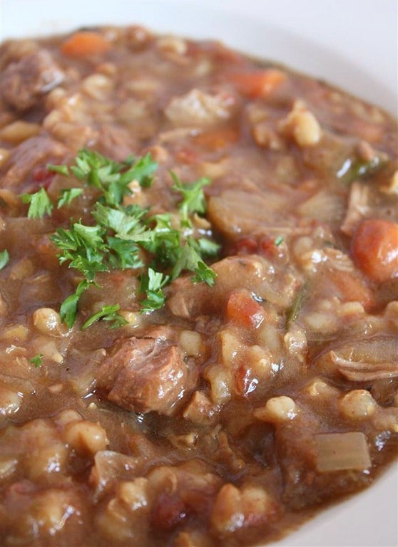 A hearty slow cooker beef barley soup will stick to your bones and keep you full all winter long. It's packed full of vegetables, barley and beef.