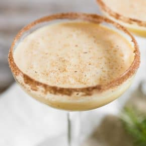 Toast to the holidays with this creamy eggnog martini. It combines delicious eggnog, vanilla vodka, amaretto, and a sprinkle of nutmeg. You'll love this tasty winter cocktail!