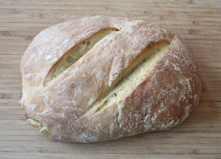 no yeast sourdough bread sitting on a wooden cutting board