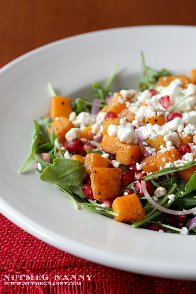 This butternut squash salad is perfect for fall. Packed full of fresh cooked butternut squash, goat cheese, arugula and pomegranate seeds.