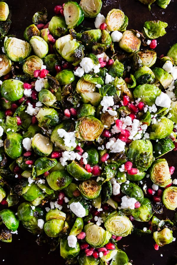 These super simple roasted Brussels sprouts with pomegranate seeds and goat cheese are the perfect dish for your Thanksgiving table. Easy to throw together and packed full of flavor!