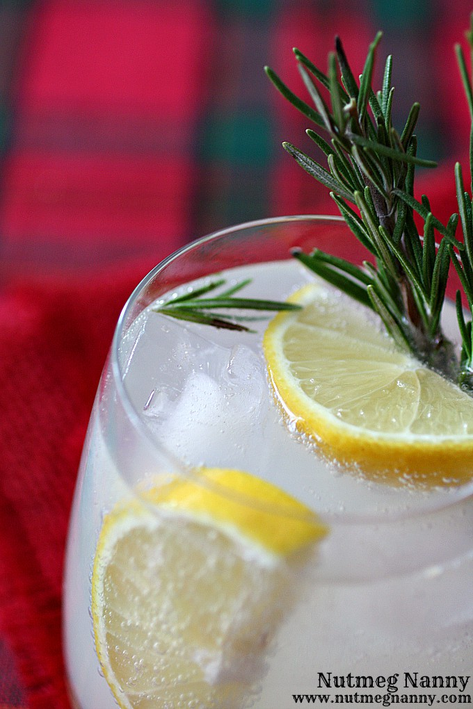 This rosemary lemon gin and tonic is the perfect holiday drink. Made with homemade honey rosemary syrup, fresh lemons, gin and tasty tonic. You'll love this!