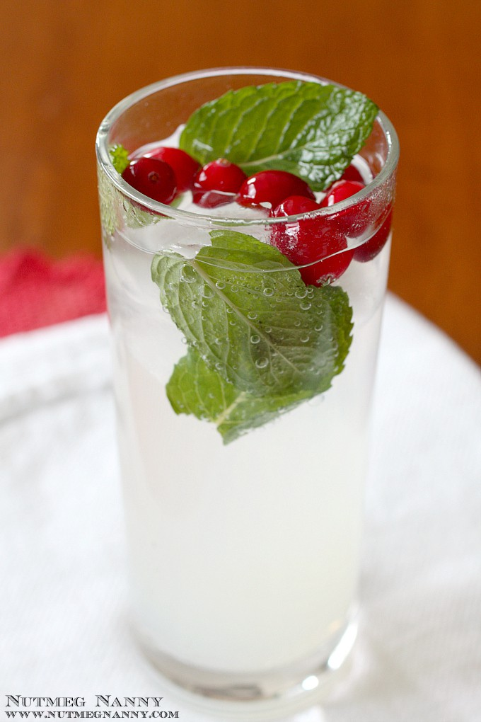 This winter dreams cocktail is full of citrus flavor and topped off with bubbly seltzer. Garnish with cranberries and mint and you have a delicious holiday cocktail!