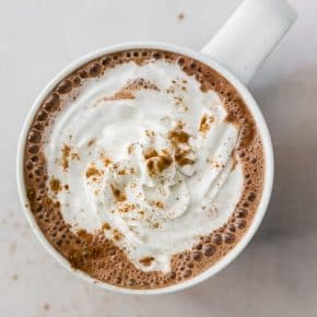 This sweet and creamy Vitamix hot chocolate is ready in just about 5 minutes and is completely made in your Vitamix. It combines semisweet chocolate, espresso powder, vanilla extact and just a touch of cinnamon. You'll love this simple and delicious hot chocolate!