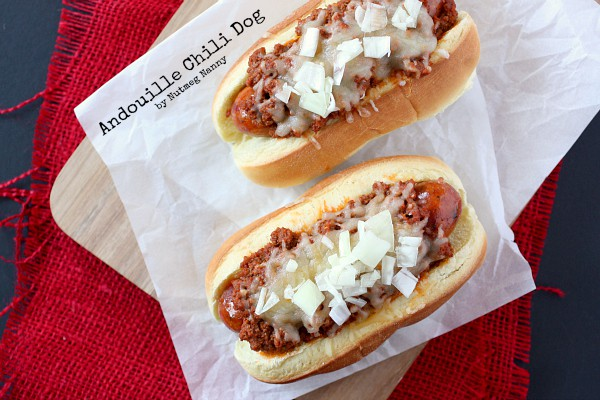 These spicy andouille chili dogs are topped with a homemade chili meat sauce, cheese and just a sprinkling of onions. Spicy and delicious!