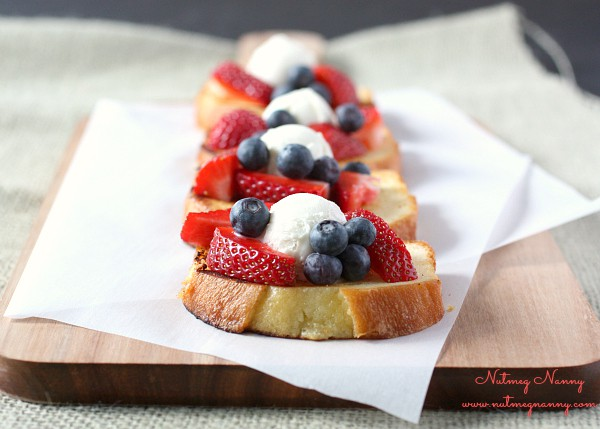 This grilled pound cake a la mode is perfect for brunch or dessert. Buttery pound cake grilled till crispy perfection and topped with fresh berries and vanilla ice cream. What is not to love about this dish?