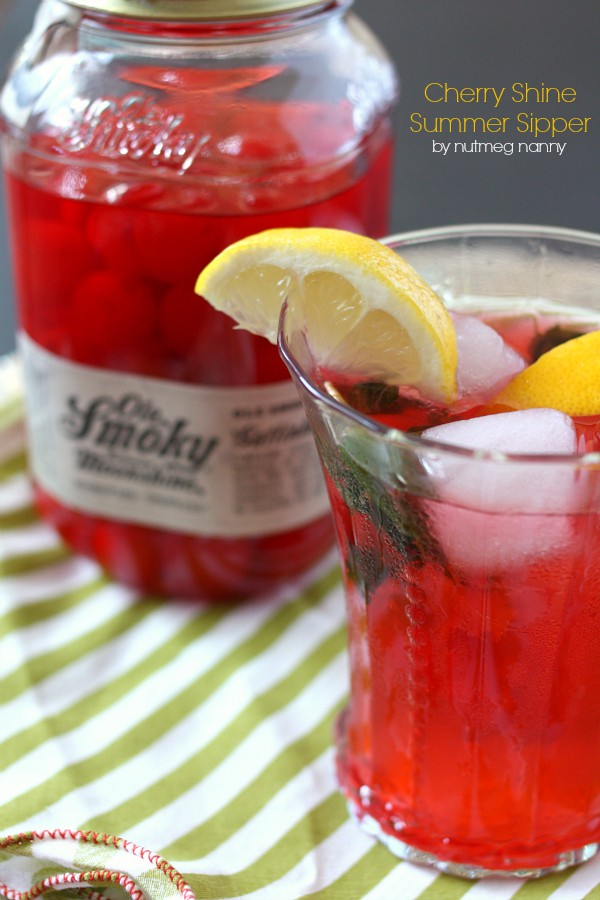 This cherry moonshine summer cocktail is the perfect way to celebrate lazy summer days. It packs a punch by using moonshine cherries, mint, lemon and bubbly seltzer water. You'll love refreshing this cocktail tastes and you'll want to make it all summer long!