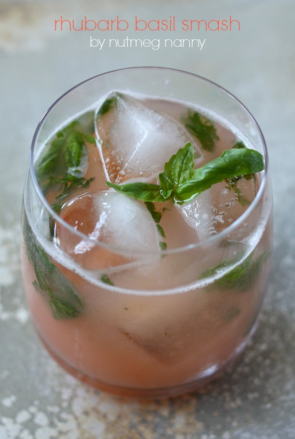 This rhubarb basil smash is the perfect summer cocktail. Delicious homemade rhubarb syrup combined with fresh basil, vodka, and bitters. You'll love this drink!