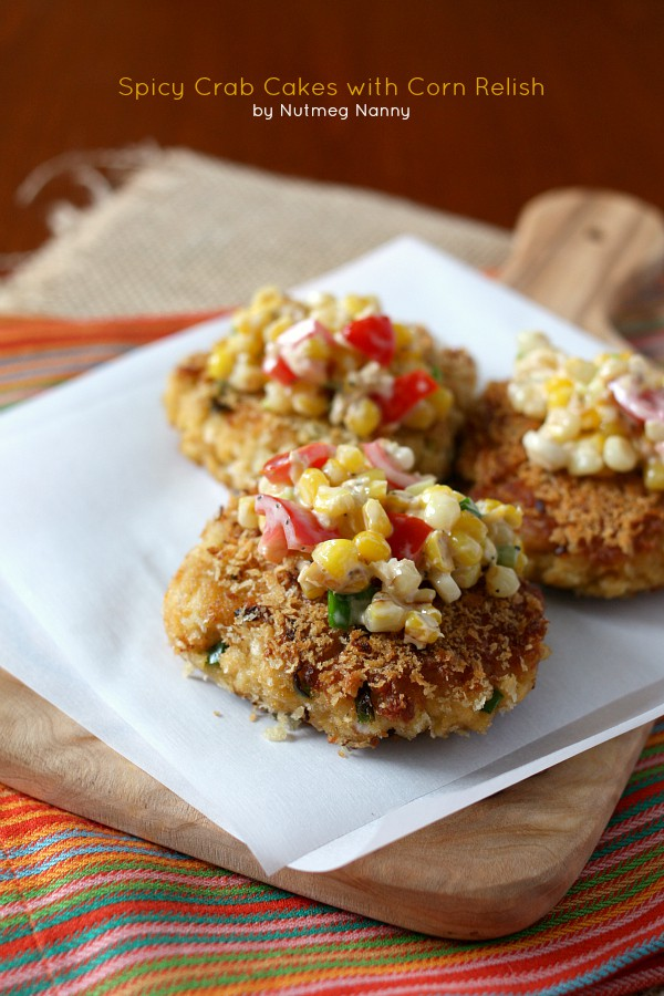 These crab cakes with sweet corn salsa are the perfect summer appetizer or main course. Made with jumbo lump crab and topped with lots of summer vegetables.