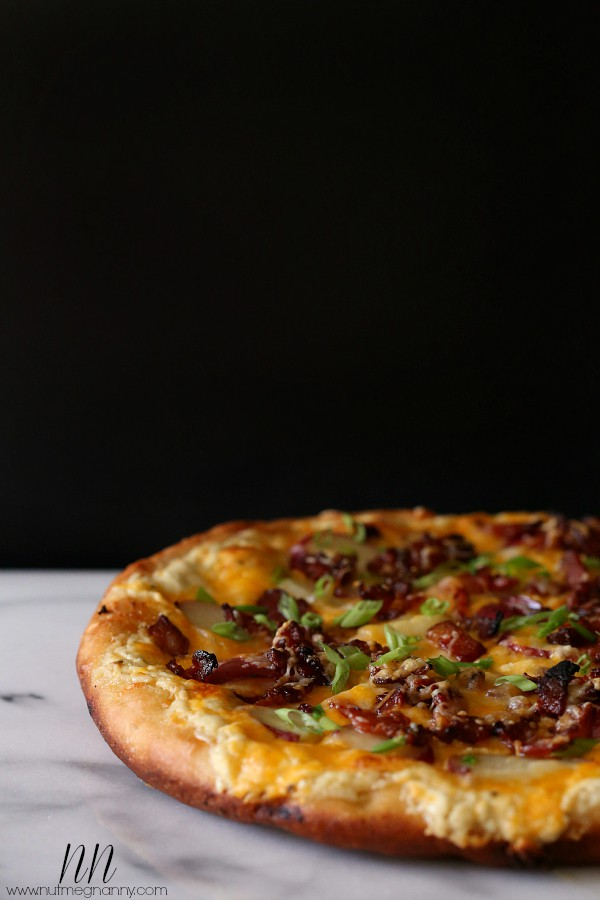 Loaded baked potato pizza combines the world's best flavors - potato, cheese and bacon! Plus you'll love this crispy deep dish pizza because it's made in a cast iron skillet!