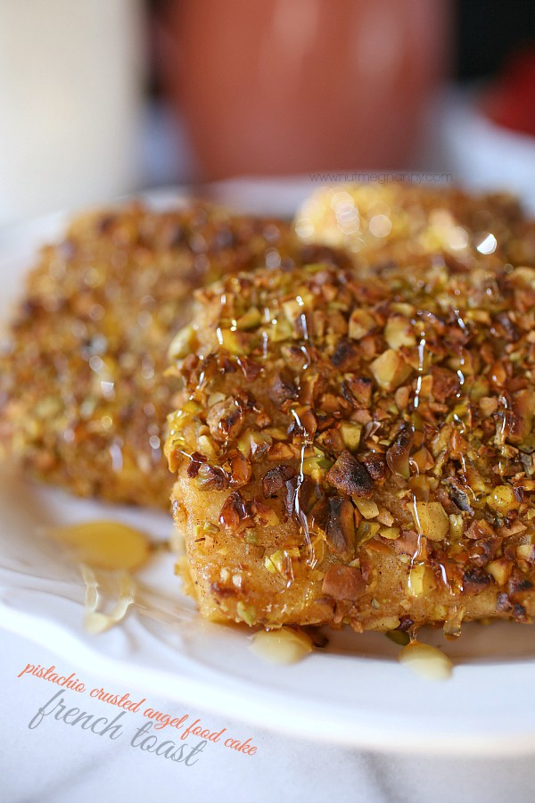 This pistachio crusted angel food cake French toast is perfectly sweet and has just the right amount of nut crunchiness. Drizzle with honey and devour.