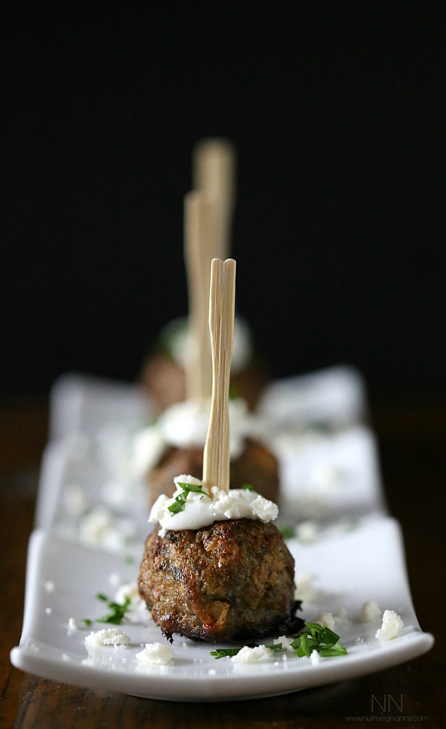 These 2 bite Greek lamb meatballs are packed full of feta cheese, spices and served with a homemade tzatziki sauce. They are a perfect appetizer or dinner!