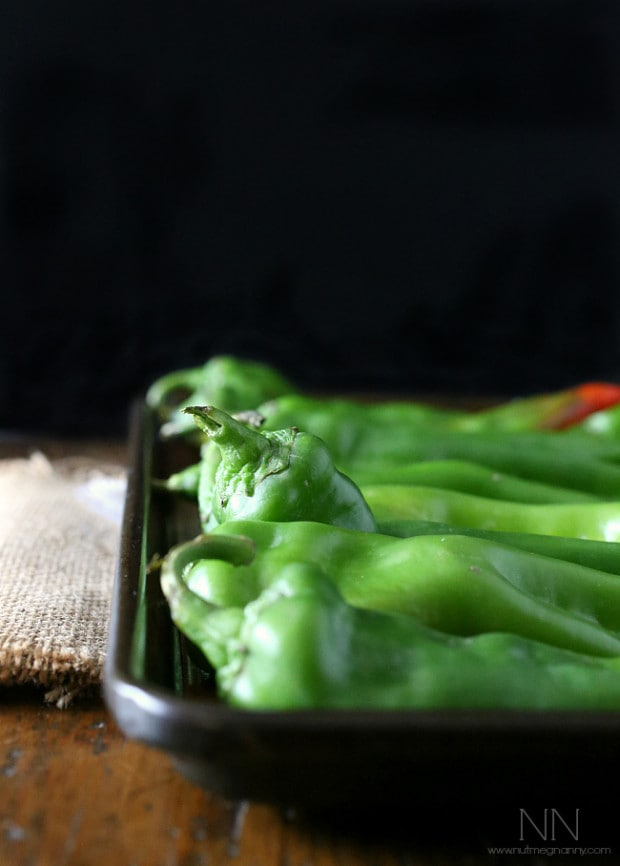 hatch green chiles sitting on a baking sheet