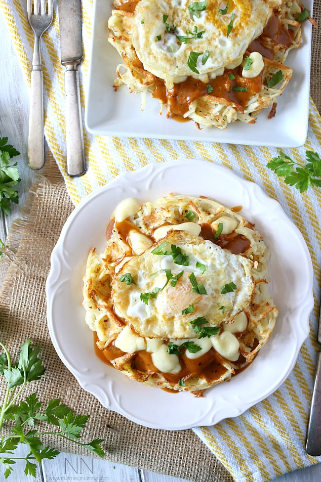 These crispy poutine hash brown waffles are the perfect way to start the day. Crispy potato waffles, homemade gravy, cheese curds and a fried egg. Hello breakfast!