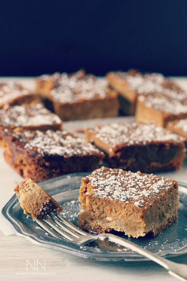 These pumpkin pie cake bars are like two desserts in one. Cake like bottom topped with a moist pumpkin pie top sprinkled with powdered sugar. Perfect for Thanksgiving!