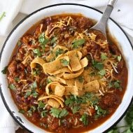 This slow cooker pumpkin chili is packed full of pumpkin puree, spicy Italian sausage and lots of beans and vegetables. This hearty soup is perfect for cold winter nights.