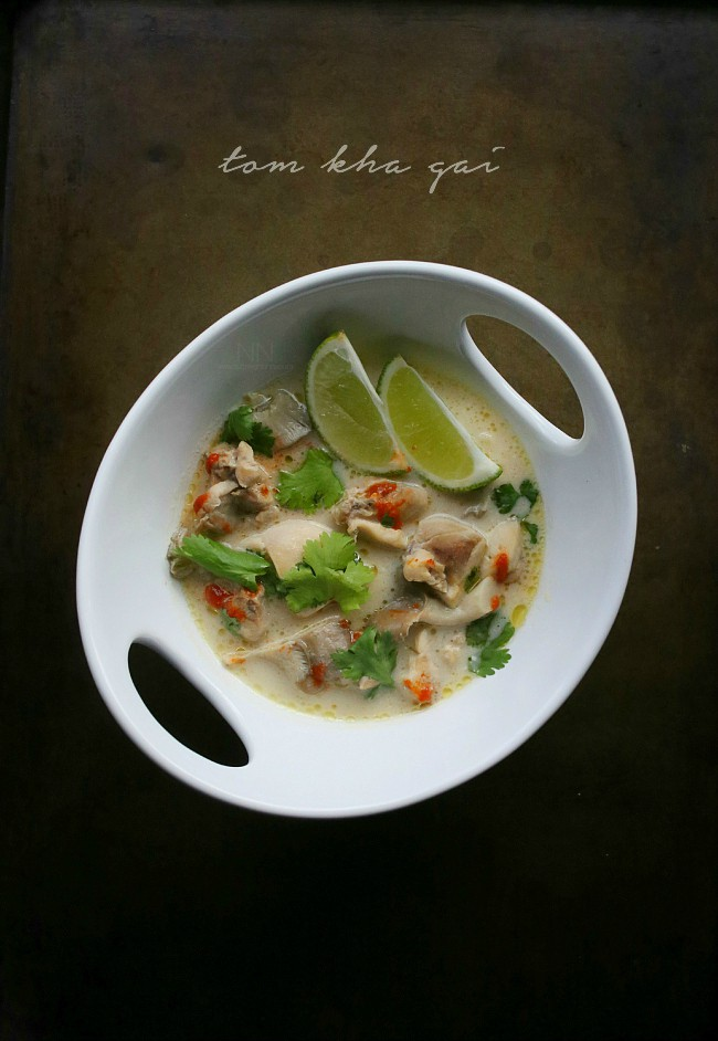 This Thai tom kha gai soup is a beautiful combination of chicken, mushrooms, ginger, lemongrass and coconut milk. Top with sriracha, cilantro and just a squeeze of lime.
