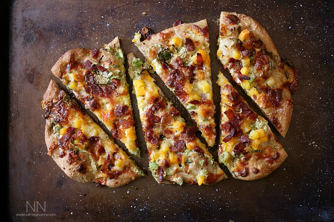 This bacon brussels sprouts butternut squash flatbread is packed full of autumnal flavor and cheesy cheddar cheese. Super simple to make and ready in just 20 minutes.