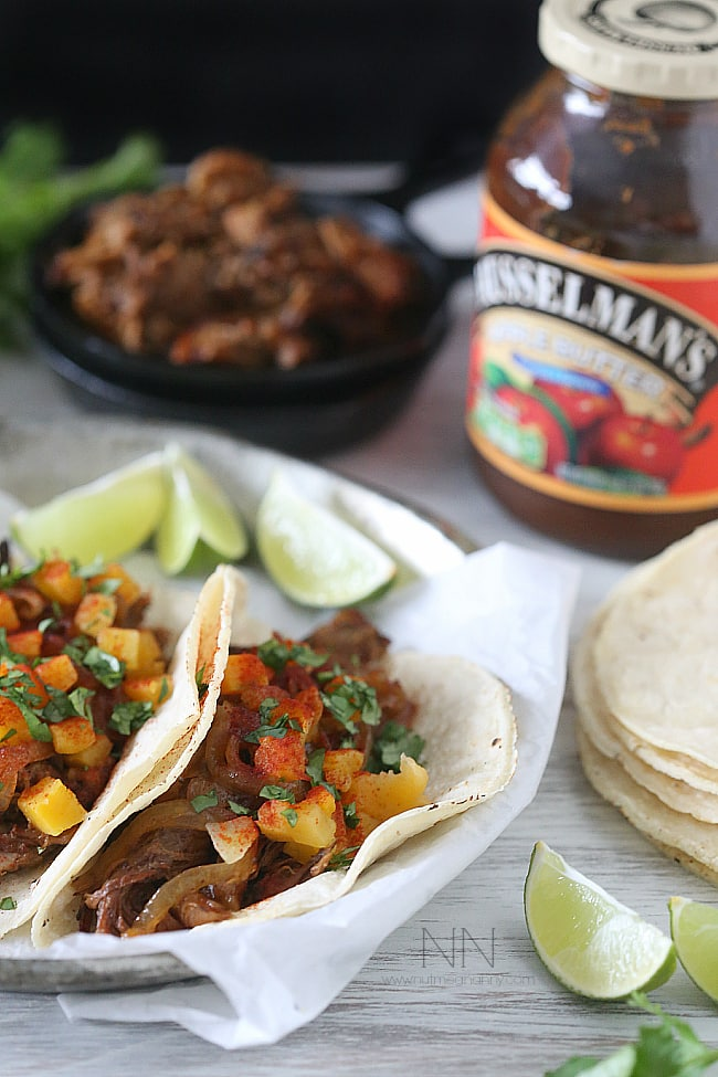 These chipotle apple butter carnitas are topped with apple cider sautéed onions and spiced butternut squash. This is one pork dish you will be craving!