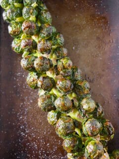 on the stalk roasted Brussels sprouts on a sheet pan
